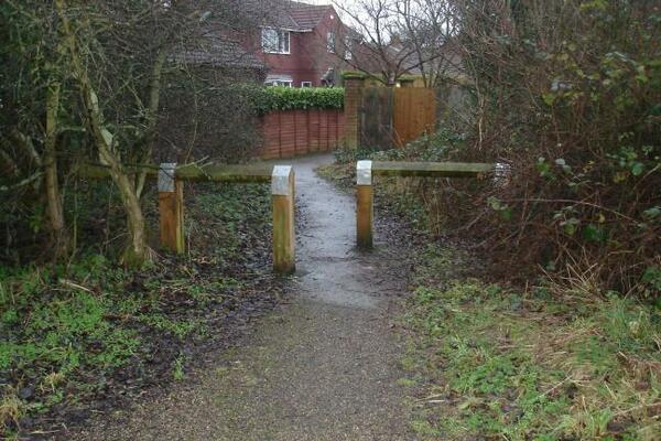 The photo for Barriers between cycle path and housing estate.